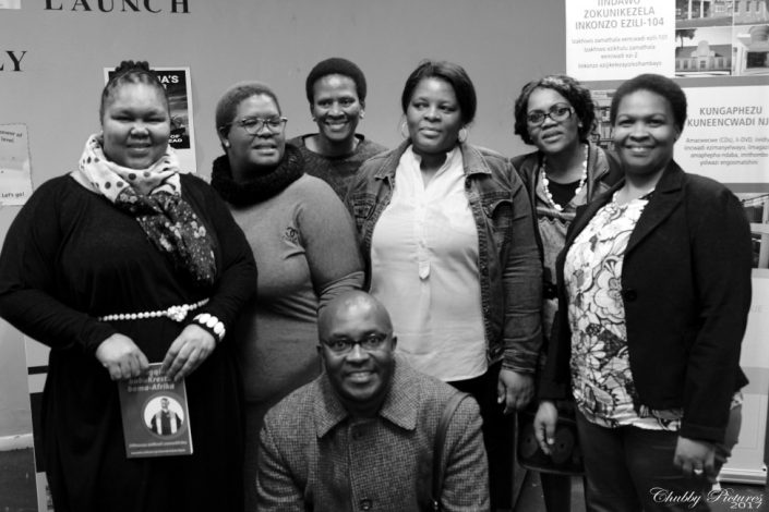 Themba with the event hosts (l to r) Ms J Kwezi Area Head Khayelitsha Libraries, Vuyokazi Rani-Njambatwa, Senior Librarian at Khayelitsha Public Library and some members of the audience