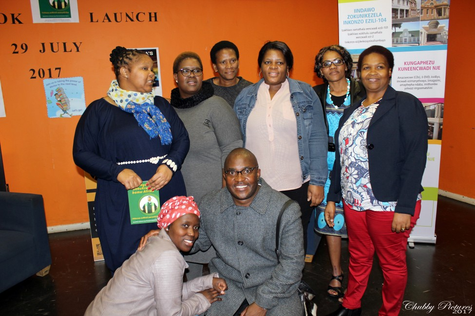 Themba with the event hosts (l to r) Ms J Kwezi Area Head Khayelitsha Libraries, Vuyokazi Rani-Njambatwa, Senior Librarian at Khayelitsha Public Library and some members of the audience
